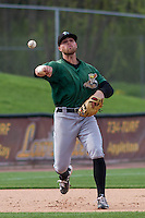 Clinton LumberKings infielder Logan Taylor (14) throws to first as he warms up prior to a Midwest League game against the Wisconsin Timber Rattlers on May 9th, 2016 at Fox Cities Stadium in Appleton, Wisconsin.  Clinton defeated Wisconsin 6-3. (Brad Krause/Four Seam Images)