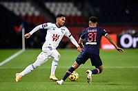 24th December 2020; Paris, France; French League 1 football, Paris St Germain versus Strasbourg;   Kenny LALA  Strasbourg  takes on Colin Dagba  PSG