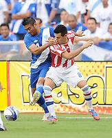 Guatemala defender Carlos Gallardo (4) goes against Paraguay midfielder Hernan Perez (8)   Guatemala tied Paraguay 3-3 in a international friendly match at RFK Stadium, Wednesday August 15, 2012.