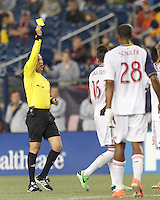 Yellow Card: Real Salt Lake defender Carlos Salcedo (16). Issued by Jose Carlos Rivero. In a Major League Soccer (MLS) match, Real Salt Lake (white)defeated the New England Revolution (blue), 2-1, at Gillette Stadium on May 8, 2013.