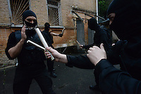 """Inside one of the occupied buildings in Kiev, Activists of the so called """"Praviy sector"""" train squads on fighting techniques fearing of a  Russian intervention. Kiev,  Ukraine."""