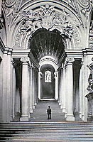 Swiss guard stands guard at the Bronze Door at the Vatican. Historical photo.