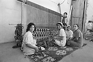 In Fez, Morocco, by tradion in a very early age, the girls are trained to make carpets. Child labor as seen around the world between 1979 and 1980 – Photographer Jean Pierre Laffont, touched by the suffering of child workers, chronicled their plight in 12 countries over the course of one year.  Laffont was awarded The World Press Award and Madeline Ross Award among many others for his work.