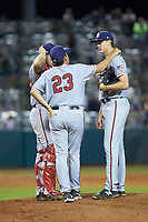 Hagerstown Suns pitching coach Mack Jenkins (23) has a chat with starting pitcher Jake Irvin (16) and catcher Nic Perkins (40) during the game against the Greensboro Grasshoppers at First National Bank Field on April 6, 2019 in Greensboro, North Carolina. The Suns defeated the Grasshoppers 6-5. (Brian Westerholt/Four Seam Images)