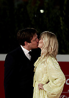 """Danish director Thomas Vinterberg kisses his wife danish actress Helene Reingaard Neumann on the red carpet for the screening of the film """"Druk"""" during the 15th Rome Film Festival (Festa del Cinema di Roma) at the Auditorium Parco della Musica in Rome on October 20, 2020.<br /> UPDATE IMAGES PRESS/Isabella Bonotto"""