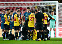 Ismaïla Sarr of Watford receives medical attention during the Sky Bet Championship behind closed doors match played without supporters with the town in tier 4 of the government covid-19 restrictions, between Watford and Norwich City at Vicarage Road, Watford, England on 26 December 2020. Photo by Andy Rowland.