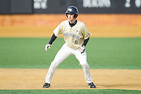 Evan Stephens (5) of the Wake Forest Demon Deacons takes his lead off of second base against the Marshall Thundering Herd at Wake Forest Baseball Park on February 17, 2014 in Winston-Salem, North Carolina.  The Demon Deacons defeated the Thundering Herd 4-3.  (Brian Westerholt/Four Seam Images)