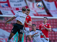 24th April 2021, Oakwell Stadium, Barnsley, Yorkshire, England; English Football League Championship Football, Barnsley FC versus Rotherham United; Michael Ihiekwe of Rotherham and Michal Helik of Barnsley challenge for a header inside the penalty area whilst Richard Wood of Rotherham and Michał Helik of Barnsley cover