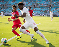 CHARLOTTE, NC - JUNE 23: Alphonso Davies #12 makes a run towards the goal during a game between Cuba and Canada at Bank of America Stadium on June 23, 2019 in Charlotte, North Carolina.