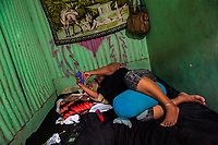A Salvadoran sex worker lies on the bed in a room where her sexual services are offered to clients in San Salvador, El Salvador, 12 April 2018. Although prostitution is not legal in El Salvador, dozens of street sex workers, wearing provocative miniskirts, hang out in the dirty streets close to the capital's historic center. Sex workers of all ages are seen on the streets but a significant part of them are single mothers abandoned by their male partners. Due to the absence of state social programs, they often seek solutions to their economic problems in sex work. The environment of street sex business is strongly competitive and dangerous, closely tied to the criminal networks (street gangs) that demand extortion payments. Therefore, sex workers employ any tool at their disposal to struggle hard, either with their fellow workers, with violent clients or with gang members who operate in the harsh world of street prostitution.