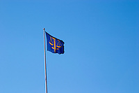 A flag on top of the Wrangelska Palatset, seat of Svea Hovratt, the appeals Court, with a symbol of justice and law, a balance. Stockholm. Sweden, Europe.