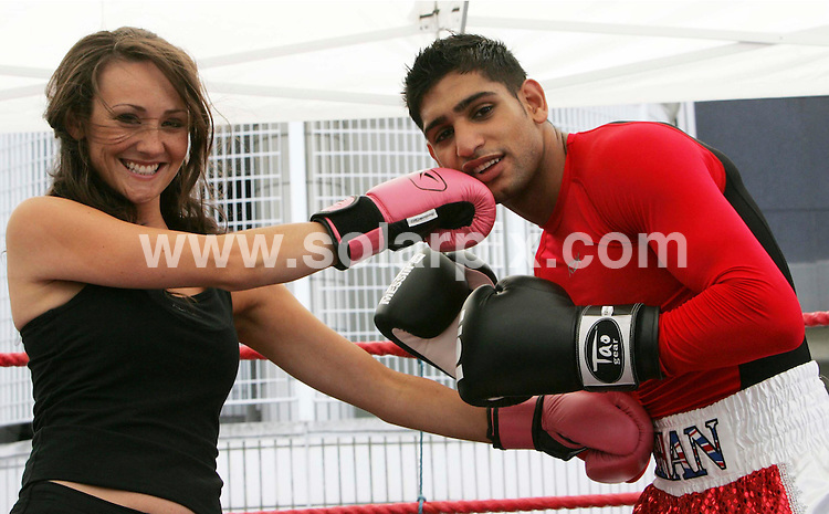 **ALL ROUND PICTURES FROM SOLARPIX.COM**.**NO UK NEWSPAPER PUBLICATION **UK MAGAZINE PUBLICATION ONLY** AND NO PUBLICATION IN FRANCE, SCANDINAVIA, AUSTRALIA AND GERMANY** .Boxing Champion Amir Khan took to the ring today with Hollyoaks star Claire Cooper to launch the national rail safety campaign  'No Messing' at Euston Station in London.JOB REF: 4371        SFE       DATE: 24.07.07.**MUST CREDIT SOLARPIX.COM OR DOUBLE FEE WILL BE CHARGED* *UNDER NO CIRCUMSTANCES IS THIS IMAGE TO BE REPRODUCED FOR ANY ONLINE EDITION WITHOUT PRIOR PERMISSION*