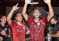 Tim Howard and Charlie Davies celebrate after the USA clinches a spot in the  2010 World Cup after defeating Honduras in 3-1 during CONCACAF qualifying in San Pedro Sula, Honduras, October 10, 2009.
