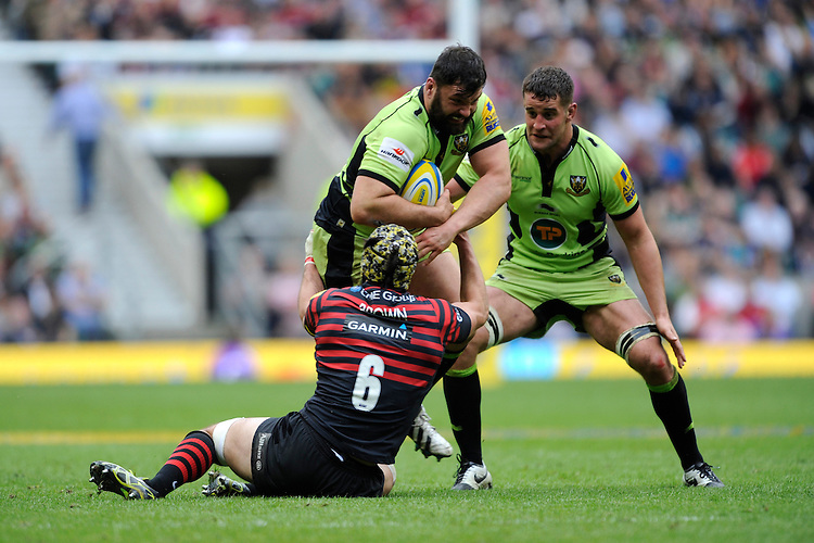 Alex Corbisiero of Northampton Saints forces his way past Kelly Brown of Saracens as Calum Clark of Northampton Saints supports during the Aviva Premiership Final between Saracens and Northampton Saints at Twickenham Stadium on Saturday 31st May 2014 (Photo by Rob Munro)