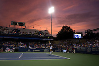 John Isner serves the ball during the Legg Mason Tennis Classic at the William H.G. FitzGerald Tennis Center in Washington, DC.  Unseeded Xavier Malisse defeated American John Isner in three sets in a thunderstorm delayed evening session.
