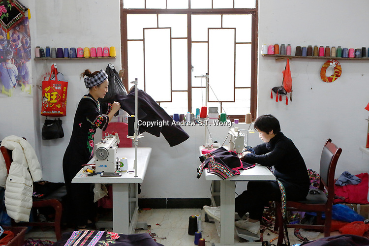 Women of the ethnic Bouyei Tribe produce traditional costumes at a garment workshop at Wangmo County in China's southwestern Guizhou Province, April 2019.
