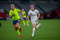 TOKYO, JAPAN - JULY 21: Megan Rapinoe #15 of the United States running during a game between Sweden and USWNT at Tokyo Stadium on July 21, 2021 in Tokyo, Japan.