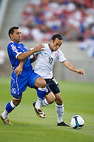 Landon Donovan of the USA and Arturo Alvarez of El Salvador battle for a ball during a World Cup Qualifying match at Rio Tinto Stadium, in Sandy, Utah, Friday, September 5, 2009.  The USA won 2-1..
