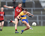 Jonathan Flynn of  Down in action against Liam Markham of Clare during their Division 2, Round 2 National League game at Cusack Park. Photograph by John Kelly.