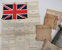 BNPS.co.uk (01202 558833)<br /> Pic: Marlow's/BNPS<br /> <br /> Pictured: A rare Far East Escape Pack<br /> consisting of a silk printed, language chart with Union Jack and phrases in various languages including Sumatran, Thai, Burmese and Tamil.<br /> <br /> A fascinating collection of rare SOE and RAF escape and evasion items have emerged for sale for thousands of pounds.<br /> <br /> The array of concealed weapons, compasses and other devices were used by World War Two operatives and airmen behind enemy lines.<br /> <br /> A stand-out lot is a MI9 cigarette lighter whose top screws off to reveal a compass, while a 3.5ins escape knife would have been hidden in an RAF 'Beadon' flying suit.<br /> <br /> The collection of 20 items boasts a concealed fishing kit, silk maps which were woven into jackets and even a miniature telescope to scout out the enemy.<br /> <br /> They are going under the hammer with Marlow's Auctions, of Stafford, Staffs.