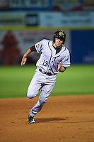 Jacksonville Suns outfielder Matt Juengel (15) running the bases during a game against the Chattanooga Lookouts on April 30, 2015 at AT&T Field in Chattanooga, Tennessee.  Jacksonville defeated Chattanooga 6-4.  (Mike Janes/Four Seam Images)