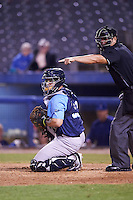 Trenton Thunder catcher Sebastian Valle (52) and umpire Jorge Teran check the runner at third during the second game of a doubleheader against the Hartford Yard Goats on June 1, 2016 at Sen. Thomas J. Dodd Memorial Stadium in Norwich, Connecticut.  Trenton defeated Hartford 2-1.  (Mike Janes/Four Seam Images)