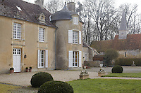 The garden facade of Gerard Tremolet's home is flanked by an 11th century chapel