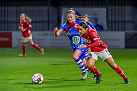 Gent's defender Lindsey Van Belle (14) and Standard forward Lola Wajnblum (11) pictured during a female soccer game between  AA Gent Ladies and Standard Femina de Liege on the 8 th matchday of the 2020 - 2021 season of Belgian Scooore Womens Super League , friday 20 th of November 2020  in Oostakker , Belgium . PHOTO SPORTPIX.BE   SPP   STIJN AUDOOREN