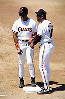 SAN FRANCISCO, CA: Coach Bobby Bonds and son Barry Bonds of the San Francisco Giants stand at first base during a game against the Philadelphia Phillies at Candlestick Park in San Francisco, California on July 24, 1993. (Photo by Brad Mangin)