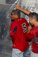 Pawtucket Red Sox infielder Reynaldo Rodriguez #5 has a beer poured over his head after game four of a best of five playoff series against the Empire State Yankees at Frontier Field on September 8, 2012 in Rochester, New York.  Pawtucket defeated Empire State 7-1 to advance to the International League Finals.  (Mike Janes/Four Seam Images)