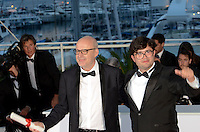 Spanish director Juanjo Gimenez (R) poses with the Palme d'Or award for Best Short Film for 'Timecode' and Brazilian director Joao Paulo Miranda Maria poses after being awarded with the Short Film Special Prize at the Palme D'Or Winner Photocall during the 69th annual Cannes Film Festival at the Palais des Festivals on May 22, 2016 in Cannes, France.