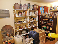 BNPS.co.uk (01202 558833)<br /> Pic: AdamPartridgeAuctioneers/BNPS<br /> <br /> Pictured: The Downstairs bedroom<br /> <br /> A huge collection of pottery and ceramics found stacked inside the suburban home of an elderly couple has sold for almost £200,000.<br /> <br /> Leonard and Alison Shurz filled every room of their three bed house with ceramic pieces they had gathered from all over the world.<br /> <br /> The Aladdin's Cave of pots, bowls, plates, vases and jugs was found by a stunned auctioneer who had the daunting task of cataloguing it all.