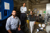 Seen here in the Space Propulsion Laboratory, lab director Dr. Paulo Lozano (center), and Ph.D. candidates Natalya Brikner and Louis Perna (left) have been working on the ion Electrospray Propulsion System (iEPS) for CubeSats at MIT in Cambridge, Massachusetts, USA.  The device is used to maneuver a 10cm cubic satellite in space. Brikner and Perna have formed a company, Accion Systems Incorporated, to commercialize the research. Brikner, graduating in Winter 2014, is CEO of the company, and Perna is co-founder. The research at MIT was done under Space Propulsion Lab director Paulo Lozano, professor in MIT's Department of Aeronautics and Astronautics.