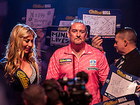21.12.2014.  London, England.  William Hill World Darts Championship.  Dean Winstanley (26) [ENG] makes his way to the stage before his match against Wayne Jones [ENG]. Winstanley won the match 3-2