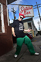 Jimmy Horn, frontman of King James and the Specialmen, poses in front of Saturn Bar where he will perform Monday nights.
