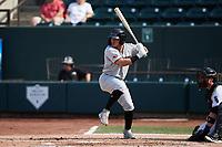 Frainyer Chavez (5) of the Hickory Crawdads at bat against the Winston-Salem Dash at Truist Stadium on July 10, 2021 in Winston-Salem, North Carolina. (Brian Westerholt/Four Seam Images)