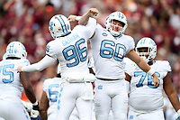 BLACKSBURG, VA - OCTOBER 19: Trevor Collins #60 and Cooper Graham #96 of the University of North Carolina celebrate a field goal during a game between North Carolina and Virginia Tech at Lane Stadium on October 19, 2019 in Blacksburg, Virginia.