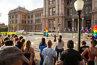 AUSTIN, TEXAS - A performer dances on the South steps of the Texas State Capitol on Saturday, Aug. 23, 2016 for the 5th Annual Stonewall Rally in observance of the 46th anniversary of the Stonewall Riots. The Stonewall Celebration pays tribute to the individuals that sparked the modern day gay rights movement in June 1969 at the Stonewall Inn on Saturday, Aug. 23, 2016. This event is sponsored by The Austin Gay & Lesbian Pride Foundation (AGLPF), Transgender Education Network of Texas, and Equality Texas.<br /> <br /> Use of this image in advertising or for promotional purposes is prohibited.<br /> <br /> Editorial Credit: Photo by Dan Herron / Herron Stock
