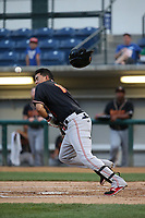 Rayder Ascanio (13) of the Modesto Nuts has his bunt bounce back to hit him in the face during a game against the Rancho Cucamonga Quakes at LoanMart Field on August 1, 2017 in Rancho Cucamonga, California. Rancho Cucamonga defeated Modesto, 2-1. (Larry Goren/Four Seam Images)