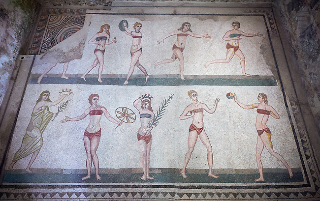 Wide picture of the Roman mosaics of the room of the Ten Bikini Girls, African birds are loaded onto a ship, room no 30, at the Villa Romana del Casale, first quarter of the 4th century AD. Sicily, Italy. A UNESCO World Heritage Site.