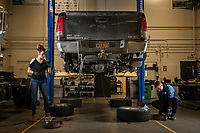 Automotive Technology students Jared Stouff, right, and Mallory Hanna, left, work on a brake assembly during instructor Randal Smith's brake systems (ADT A150) course in UAA's Automotive and Diesel Technology Building.