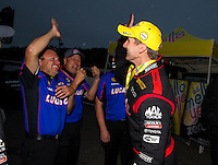 Aug 17, 2014; Brainerd, MN, USA; NHRA top fuel dragster driver Morgan Lucas celebrates with a crew members after winning the Lucas Oil Nationals at Brainerd International Raceway. Mandatory Credit: Mark J. Rebilas-