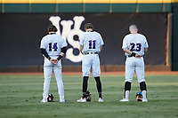 (L-R) Winston-Salem Dash outfielders Travis Maniot (14), Duke Ellis (11), and Alex Destino (23) stand for the National Anthem prior to the game against the Bowling Green Hot Rods at Truist Stadium on September 7, 2021 in Winston-Salem, North Carolina. (Brian Westerholt/Four Seam Images)