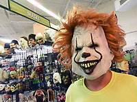 """David Henderson, a manager at Halloween Express at Frisco Station Mall in Rogers, models on Wednesday Oct. 6 2021 a mask from the character Pennywise in the movie, """"It,"""" based on a book by Stephen King. Go to nwaonlinecom/211010Daily/ to see more photos.<br />(NWA Democrat-Gazette/Flip Putthoff)"""