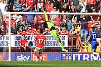 Owen Evans of Cheltenham FC punches a cross during Charlton Athletic vs Cheltenham Town, Sky Bet EFL League 1 Football at The Valley on 11th September 2021