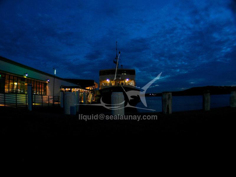 A Sydney Ferry at the Manly Wharf, Sydney by night.