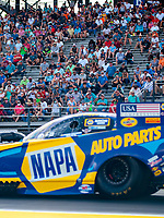 Sep 26, 2020; Gainesville, Florida, USA; General view of NHRA fans in the grandstands as funny car driver Ron Capps goes past during qualifying for the Gatornationals at Gainesville Raceway. Mandatory Credit: Mark J. Rebilas-USA TODAY Sports