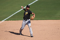 Pittsburgh Pirates third baseman Kevin Kramer (65) throws to first base during a Major League Spring Training game against the Baltimore Orioles on February 28, 2021 at Ed Smith Stadium in Sarasota, Florida.  (Mike Janes/Four Seam Images)
