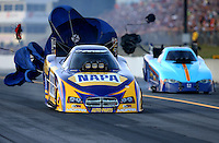 Oct 4, 2013; Mohnton, PA, USA; NHRA funny car driver Ron Capps (left) races alongside Paul Lee during qualifying for the Auto Plus Nationals at Maple Grove Raceway. Mandatory Credit: Mark J. Rebilas-