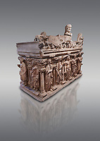 """Roman relief sculpted sarcophagus with kline couch lid with a reclining male figuer depicted, """"Columned Sarcophagi of Asia Minor"""" style typical of Sidamara, 3rd Century AD, Konya Archaeological Museum, Turkey. Against a grey background"""
